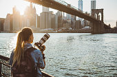 Woman photographer taking picture of Lower Manhattan