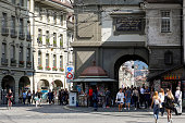 Bern Switzerland - September 14, 2018: The life of the city as seen in the very historical centre of this medieval capital. There are many people around the clock tower known as Zytglogge. The City of Bern is one of the countless great places in Switzerland and it is the political centre of this Country. numerous museums, a wide cultural offer, a variety of tourist attractions makes it a travel destination for tourists from all over the world.