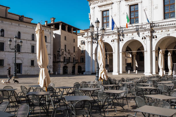 the life under italy's coronavirus lockdown. piazza della loggia (loggia square) in brescia, lombardy - della stock pictures, royalty-free photos & images
