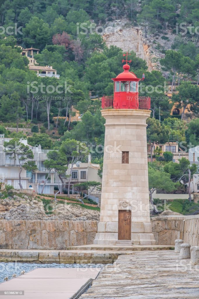 The lighhouse of Port d'Andratx, a resort town, marina and harbor of the  ancient town of Andratx, on the southwest corner of Majorca (Mallorca), Balearic Islands, Spain stock photo