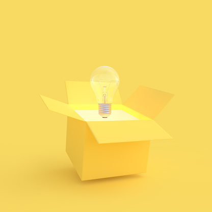 istock The light bulb drifted out of the gift box yellow color 1080555974