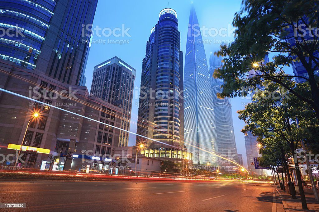 the light trails with modern building stock photo