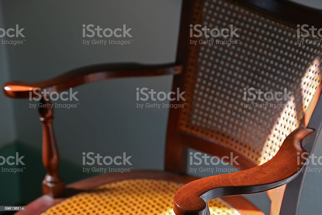 The light which is lighted up by the chair stock photo