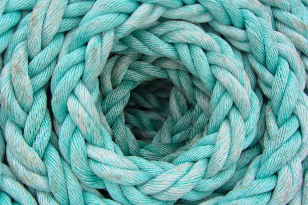 The light-blue rope is twisted by a ring, background, texture stock photo