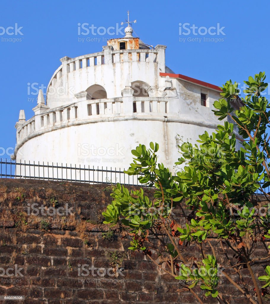 The lighthouse and fortress walls of Fort Aguada, Goa, India stock photo