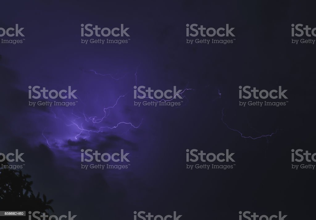 The lightning bolt shines down from the beautiful sky. stock photo