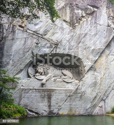 The Lion of Lucerne, is a rock relief in Lucerne, Switzerland, designed by Bertel Thorvaldsen and hewn in 1820–21 (German: Lowendenkmal), carved on the face of stone cliff with the pond in the foreground