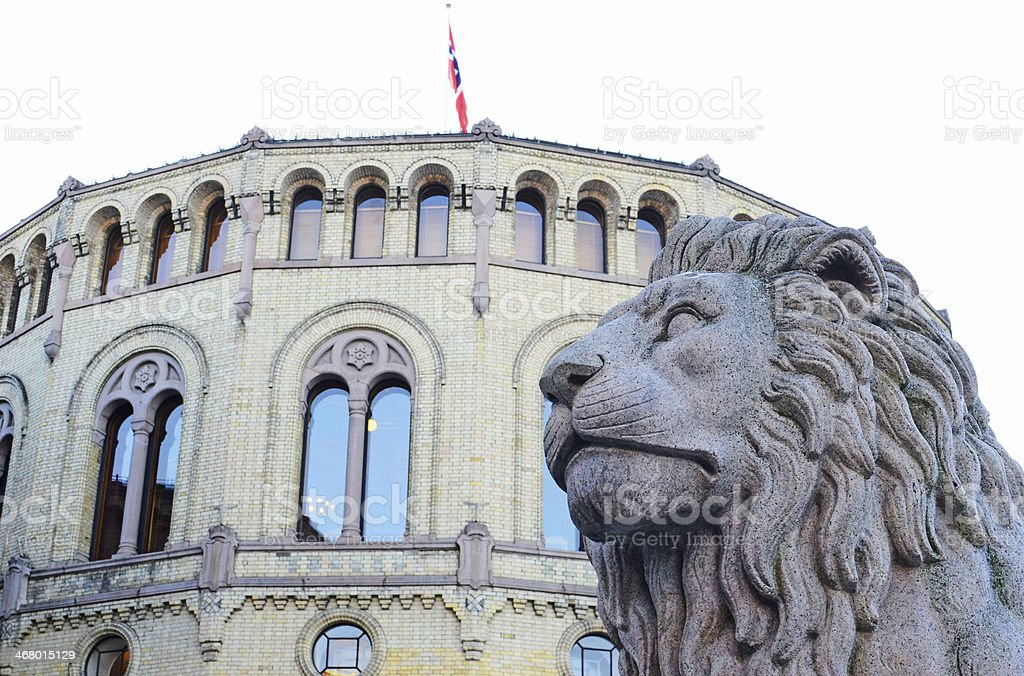 The lion outside the Norwegian parliament stock photo