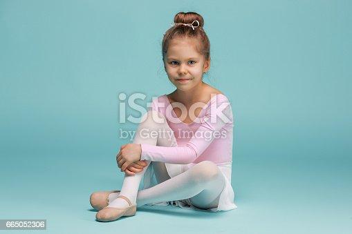 819677734 istock photo The little balerina dancer on blue background 665052306