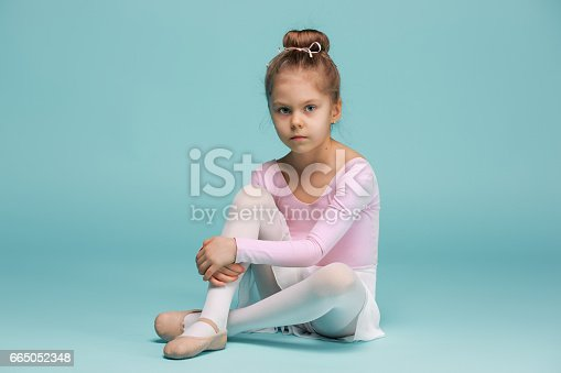 819677734 istock photo The little balerina dancer on blue background 665052348