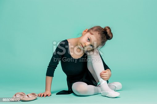 819677734 istock photo The little balerina dancer on blue background 665056172