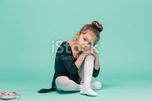 819677734 istock photo The little balerina dancer on blue background 665056198