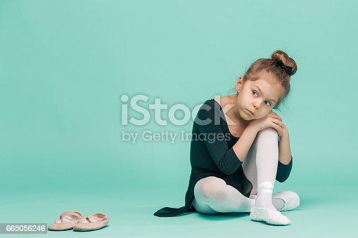 819677734 istock photo The little balerina dancer on blue background 665056246