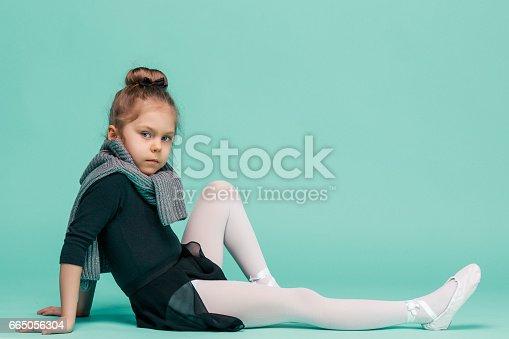 819677734 istock photo The little balerina dancer on blue background 665056304