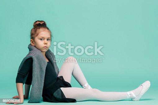 819677734 istock photo The little balerina dancer on blue background 665056356
