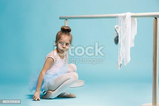 819677734 istock photo The little balerina dancer on blue background 665058906