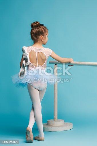 819677734 istock photo The little balerina dancer on blue background 665059022