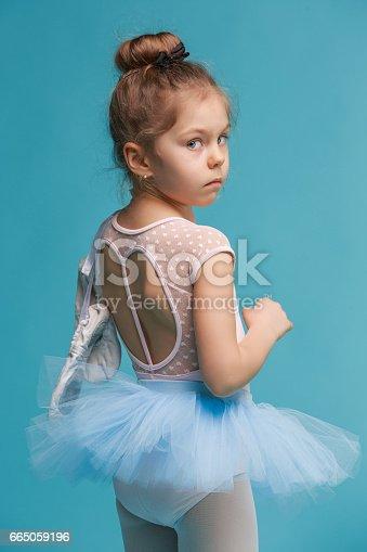 istock The little balerina dancer on blue background 665059196