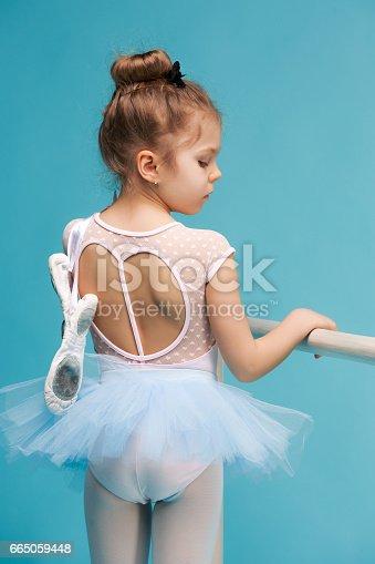 istock The little balerina dancer on blue background 665059448