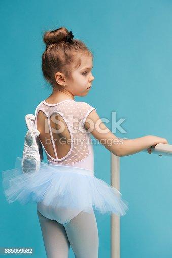 istock The little balerina dancer on blue background 665059582