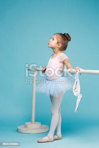istock The little balerina dancer on blue background 665059660