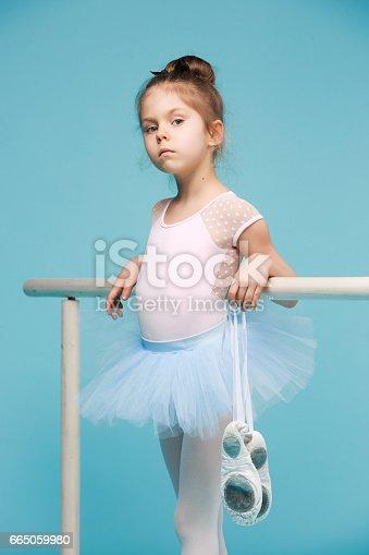 istock The little balerina dancer on blue background 665059980