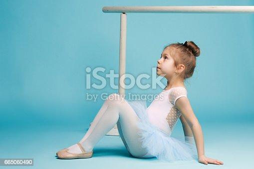 819677734 istock photo The little balerina dancer on blue background 665060490