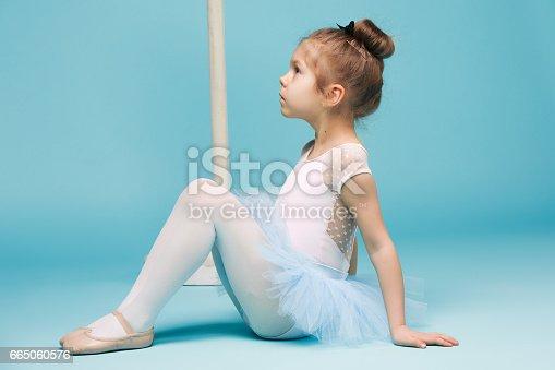 819677734 istock photo The little balerina dancer on blue background 665060576