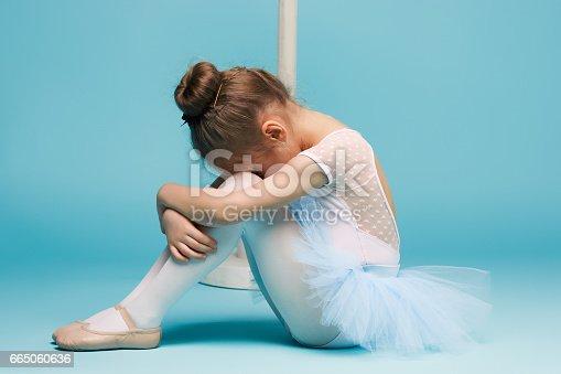 819677734 istock photo The little balerina dancer on blue background 665060636