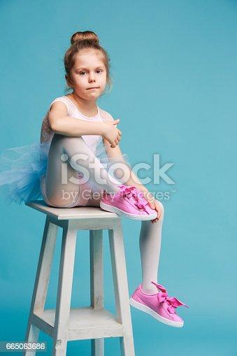 istock The little balerina dancer on blue background 665063686