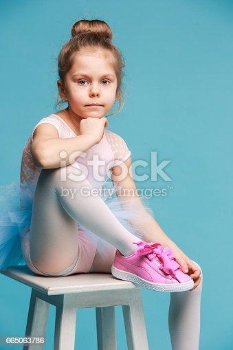 istock The little balerina dancer on blue background 665063786