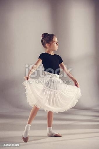 819677734 istock photo The little balerina dancer on gray background 903641008