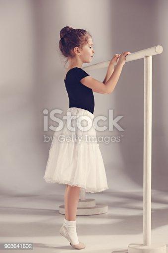 819677734 istock photo The little balerina dancer on gray background 903641602