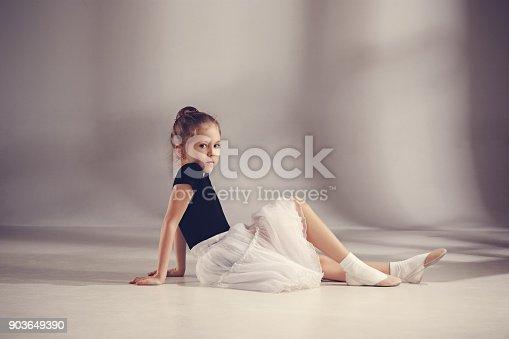 819677734 istock photo The little balerina dancer on gray background 903649390