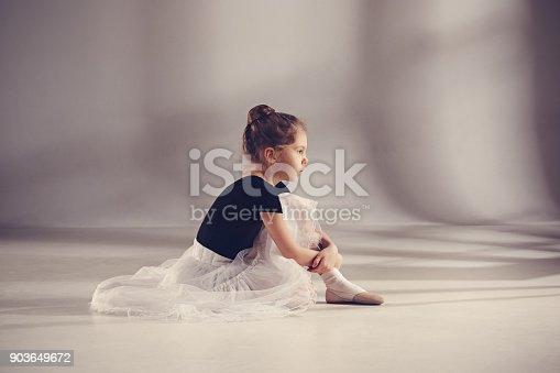 819677734 istock photo The little balerina dancer on gray background 903649672