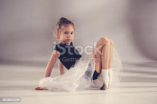 819677734 istock photo The little balerina dancer on gray background 903650036