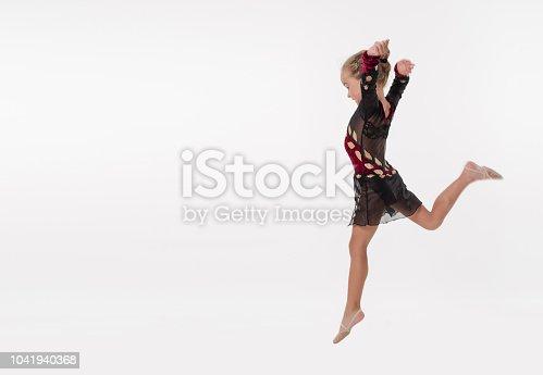 466300721 istock photo The little ballerina dancer jumping in studio 1041940368