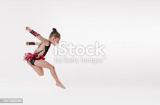 466300721 istock photo The little ballerina dancer jumping in studio 1041992034