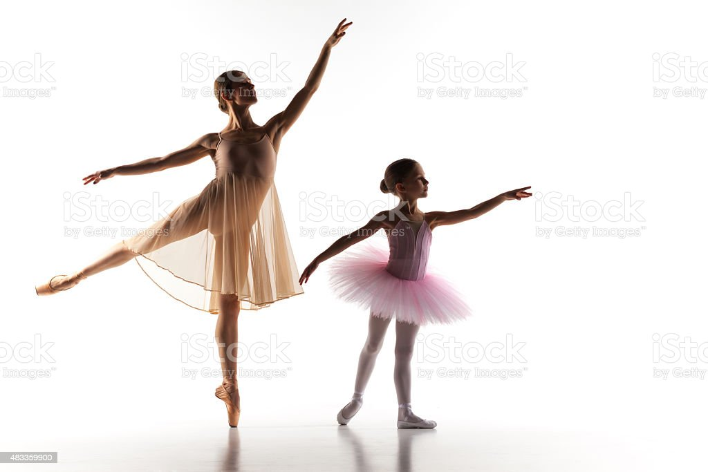 The little ballerina dancing with personal ballet teacher in dance stock photo