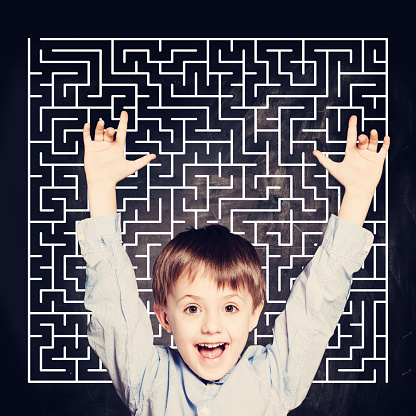 istock The little boy finds a solution to the problem. The student screams with joy. 1200393518