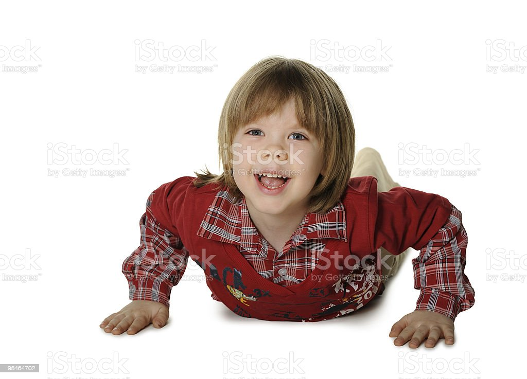 The little boy lays on a floor royalty-free stock photo