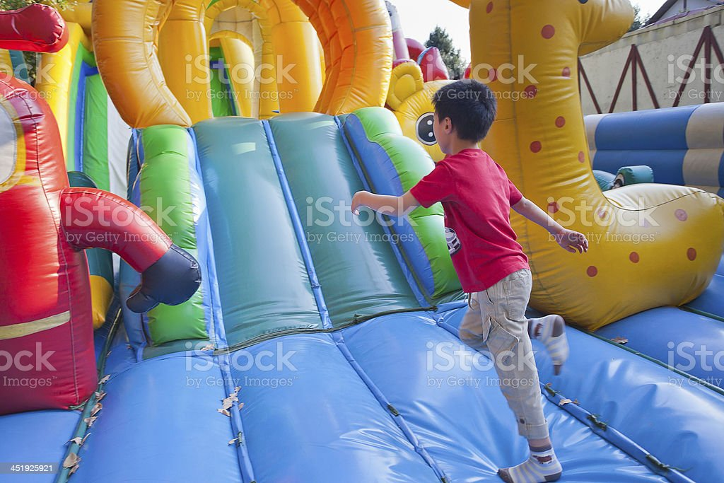 The little children on a trampoline. stock photo