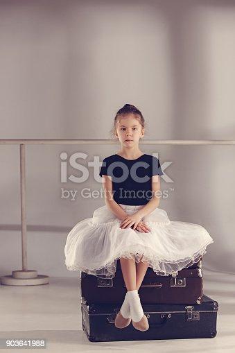 819677734 istock photo The little girl as balerina dancer sitting at studio 903641988
