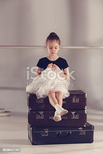 819677734 istock photo The little girl as balerina dancer sitting at studio 903642142