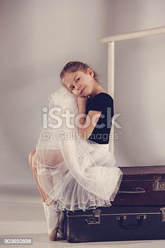 819677734 istock photo The little girl as balerina dancer sitting at studio 903650898