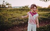 The little girl enjoys the forest