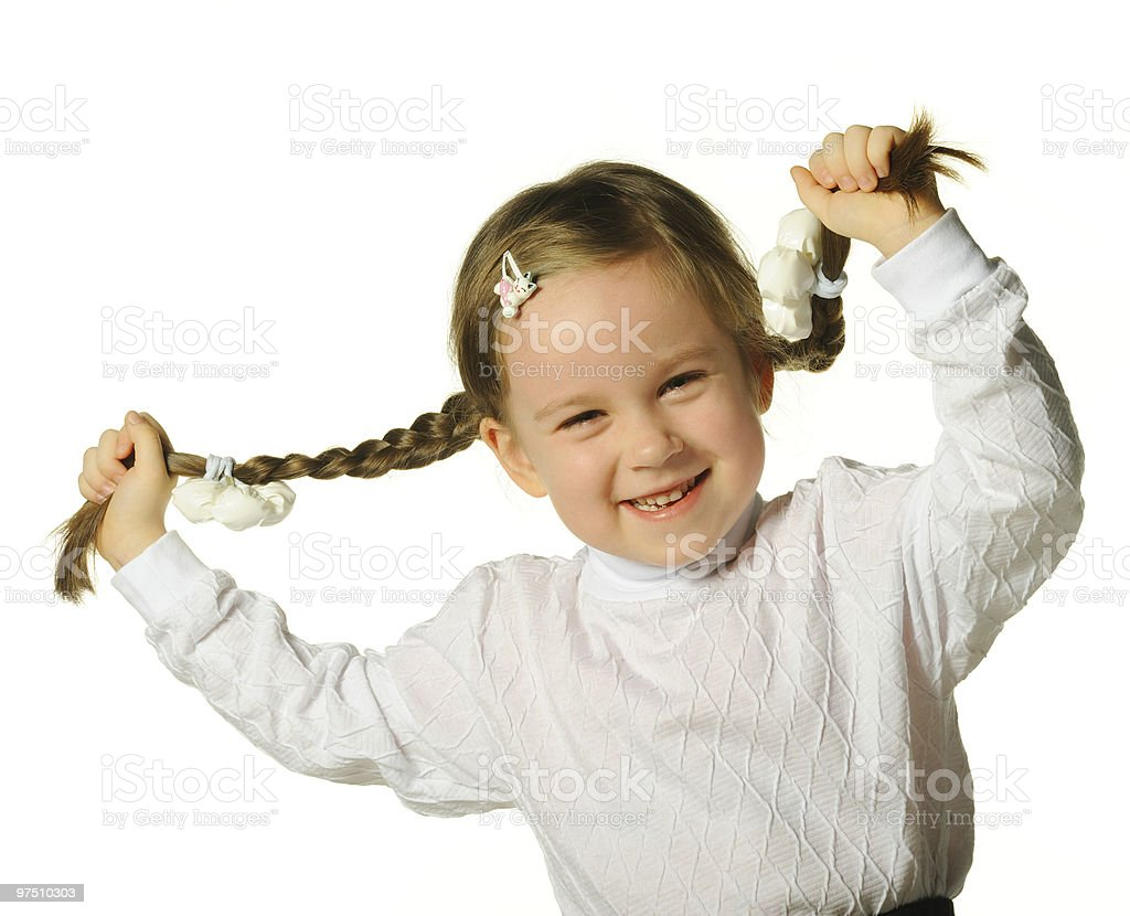 The little girl holds hands braids royalty-free stock photo