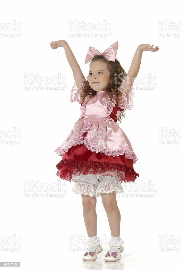 The little girl in a doll festive attire for masquerade royalty-free stock photo