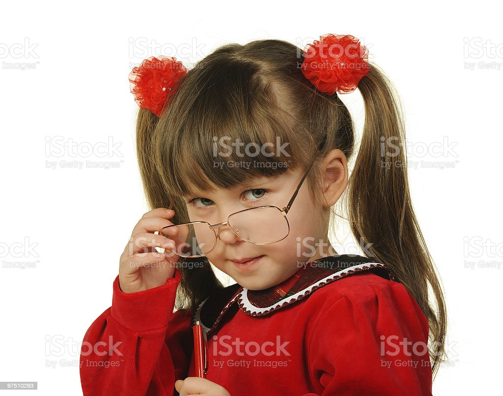 The little girl in big glasses and with pen royalty-free stock photo
