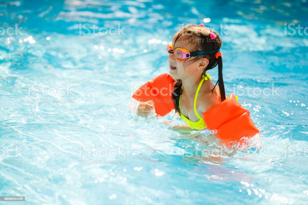 underwater water park. The Little Girl In Water Park Swimming Underwater And Smiling Royalty-free Stock Photo